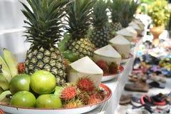 Banana, rambutan, coconut, orange and pineapple in zinc salver Stock Photo