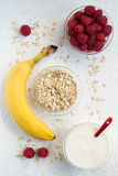 Banana, Raspberries and Yogurt Oatmeal Breakfast Set Stock Photography