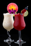 Banana and Raspberry Daiquiri. Cocktails. Rum, banana, raspberry, liqueur, lime juice garnished with lime and fresh raspberries over black background. Most royalty free stock image