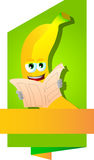 Banana reading newspaper label with blank ribbon Royalty Free Stock Photography