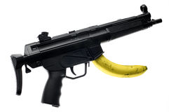 Banana republic. Nice image to represent this popular expression (banana republic). This gun is a plastic replica Stock Images