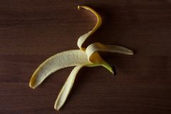 Banana rind on a brown wooden table. stock photo