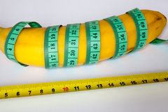Banana with a ruler Stock Images