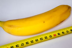 Banana with a ruler Stock Photos