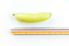 Banana with ruler Stock Photo