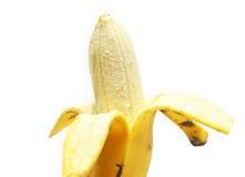 Banana sbucciata metà Fotografie Stock Libere da Diritti