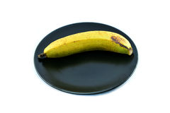 Banana Single on plate Stock Photos