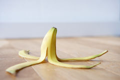 Banana skin on floor Stock Photos