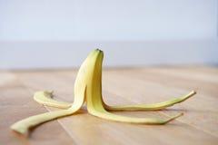 Banana skin on floor Stock Photos