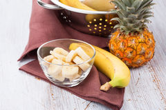 Banana sliced in bowl  and pineapple Royalty Free Stock Photography