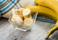 Banana sliced in bowl Stock Photos