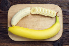 Banana and a sliced Stock Image