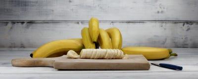 Banana. Sliced banana on wooden board Royalty Free Stock Images