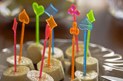 The banana slices,decorated with colorful peaks for canapés, festive dish Stock Photography