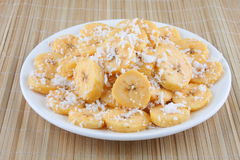 Banana slices with honey and coconut Stock Photography