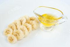 Banana slices and honey Stock Images