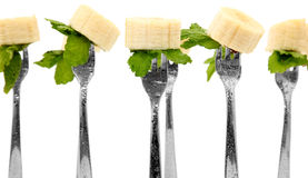 Banana Slices and Mint Leaves on Forks Stock Photo