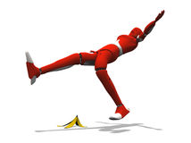 Banana Slipping. Crash test dummy slipping with a banana over a white background Royalty Free Stock Image