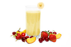 Banana smoothie. Fruit smoothie with  cherry, strawberry and  peach isolated on white background Stock Images