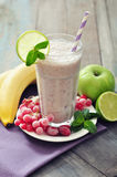 Banana smoothie  with berries Stock Image