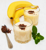 Banana smoothie. With chocolate on a old white wooden background Stock Image