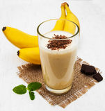 Banana smoothie. With chocolate on a old white wooden background Royalty Free Stock Photography