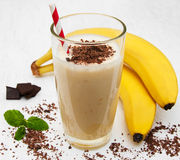 Banana smoothie. With chocolate on a old white wooden background Royalty Free Stock Image