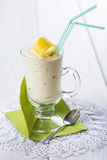 Banana smoothie decorated with a lemon zest Royalty Free Stock Images