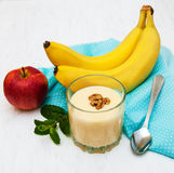 Banana smoothie. And fruits on a wooden background Royalty Free Stock Photos