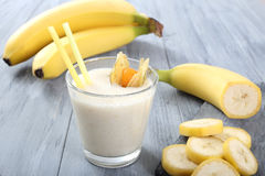 Banana smoothie. Glass with fresh banana smoothie Royalty Free Stock Images