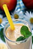 Banana smoothie. Glass of fresh banana peach smoothie close up Stock Images