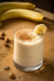 Banana smoothie in glass Stock Image
