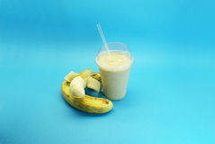 Banana smoothie and granola. Liquefied banana and granola , served in plastic cup and straw Stock Image