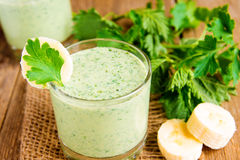 Banana smoothie with herbs Stock Photo