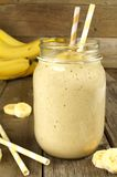 Banana smoothie in a jar on wood Royalty Free Stock Photography