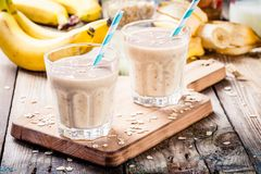 Banana smoothie with oatmeal, peanut butter and milk Stock Images