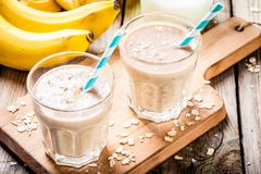 Banana smoothie with oatmeal, peanut butter and milk Stock Photo