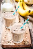 Banana smoothie with oatmeal, peanut butter and milk Royalty Free Stock Photo