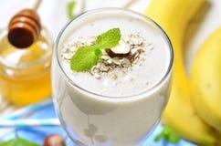 Banana smoothie with oats and hazelnuts. Stock Photo