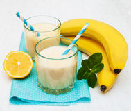 Banana smoothie. On a old white wooden background Stock Images