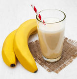 Banana smoothie. On a old white wooden background Stock Image