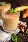 Banana smoothie with pear and cinnamon Royalty Free Stock Photography