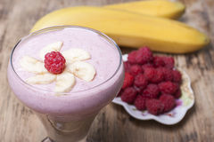 Banana smoothie with raspberries . Stock Photography