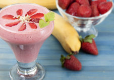 Banana smoothie with strawberries Royalty Free Stock Image