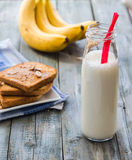 Banana smoothie, toast with peanut butter, roasted peanuts, brea Stock Image