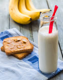 Banana smoothie, toast with peanut butter, roasted peanuts, brea Stock Photo