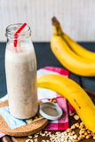 Banana smoothie with walnut paste Stock Image