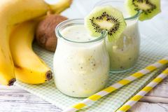Free Banana Smoothie With Kiwi And Oats On A Light Wooden Table. Royalty Free Stock Images - 67572159