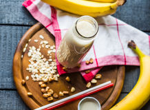 Free Banana Smoothie With Oat Flakes And Milk In The Bottle Stock Photos - 47650473