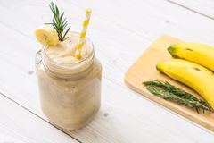 banana smoothies glass stock photo